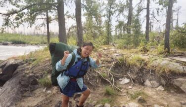 Lee Vue portaging with pack in the BWCA
