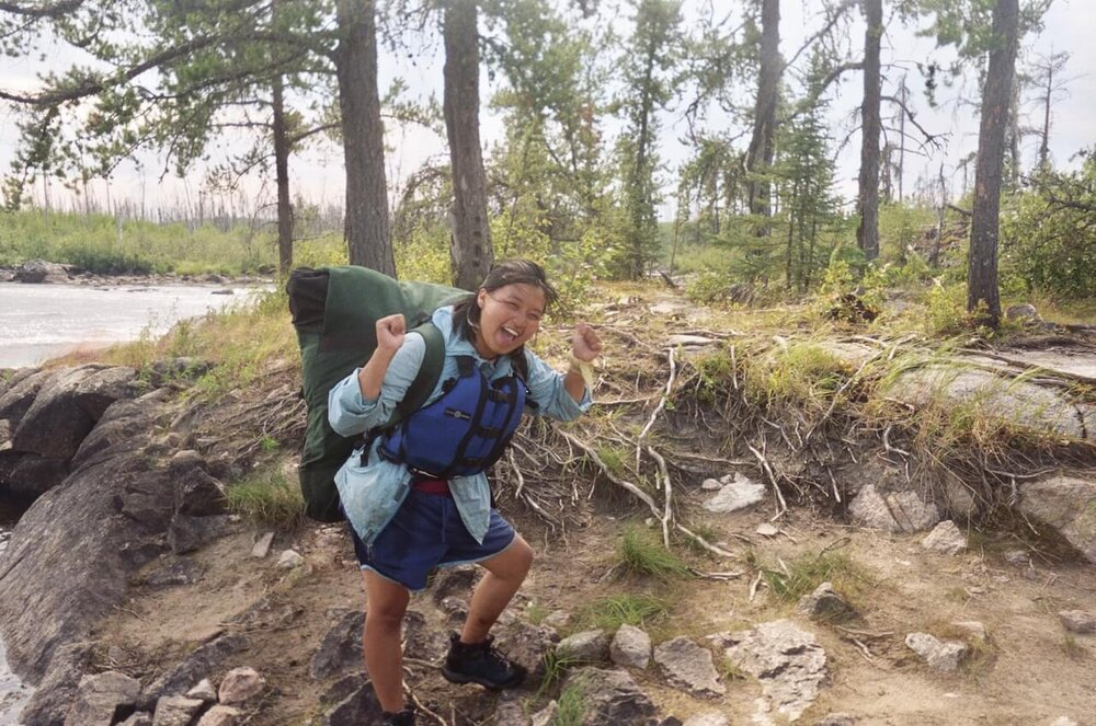 Lee Vue portaging with a pack in the BWCA