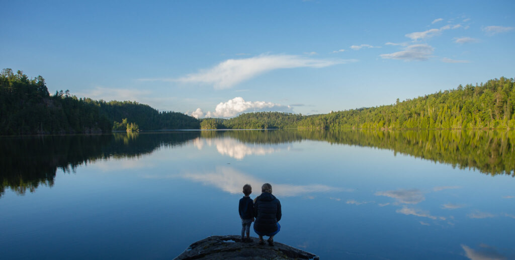 Woman and child looking at clean lake in the Boundary Waters