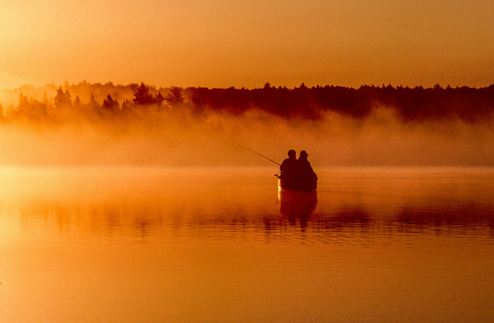 Image of two people in a canoe fishing the Boundary Waters