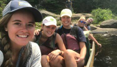 Cecilia Meyerson and bachelorettes in a canoe in the BWCA