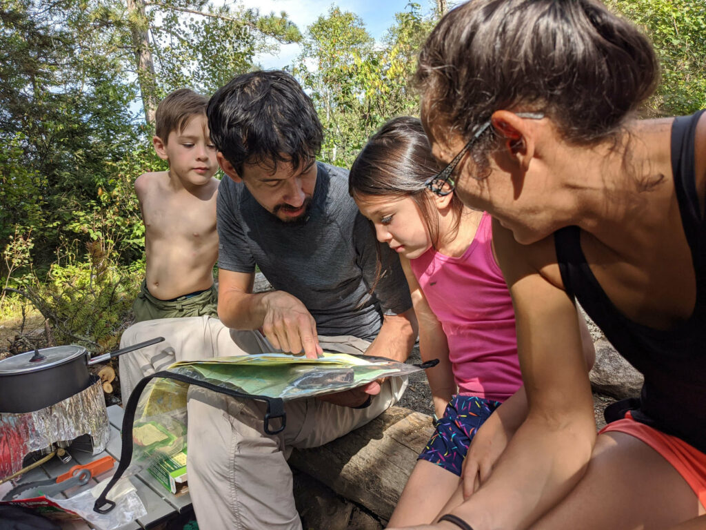 Image of a family navigating the Boundary Waters using a map.