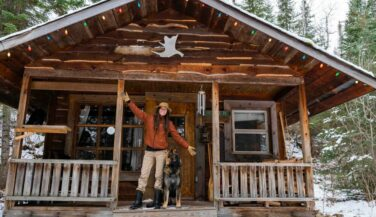 Ashley Bredemus on the porch of her cabin.