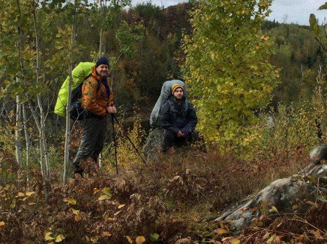 Two men hiking the Boundary Waters
