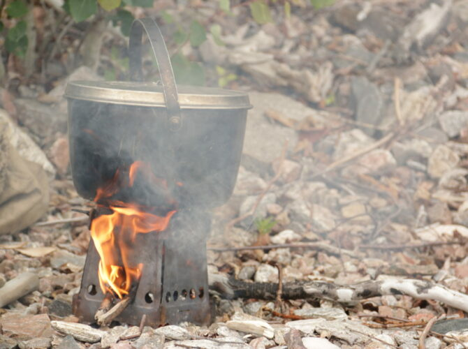 Image of a pot over a campfire in the Boundary Waters