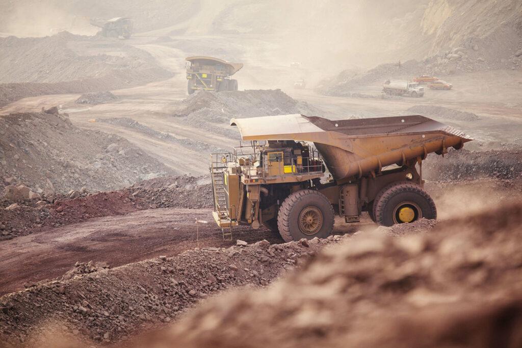 Dump Trucks working on a Polymet Mining site.