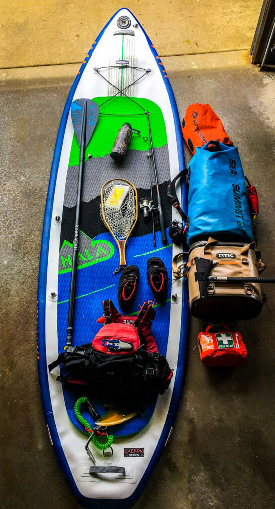 A stand up paddle board with all necessary gear.