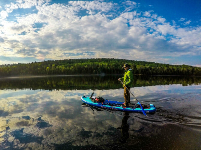 Image of a man using a stand up paddle board in the Boundary Waters