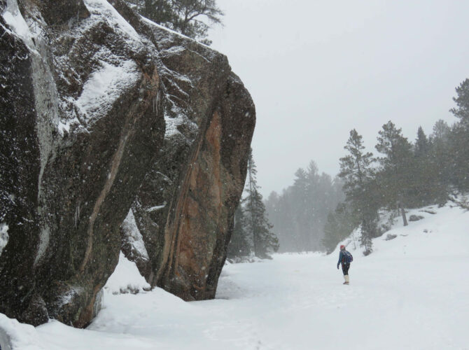 Image of a man hiking in the snow in the Boundary Waters