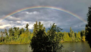 Rainbow over a kevlar canoe in the BWCAW