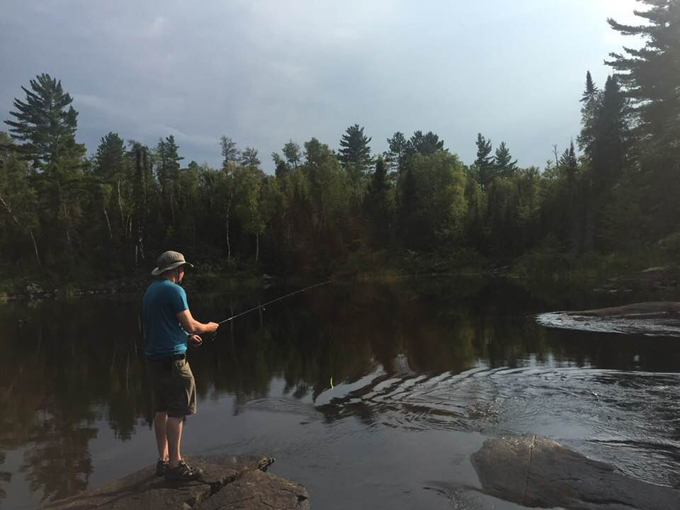 Man fishing from the shore in the BWCA.