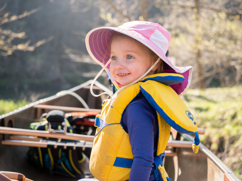 Smiling child in a canoe in the BWCA