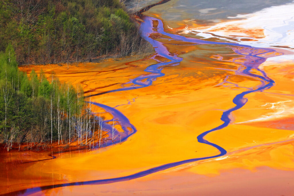 Toxic waste runoff spilled into the waters of the Boundary Waters. Caused by mining.
